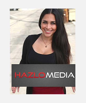 Hazlo Media girl with sign